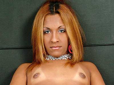 Horny shemale massaging her erection